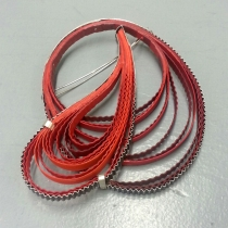 Red paper and silver brooch by Clara Breen