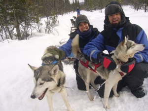 Becky and her husband dog sledding in Northern Sweden