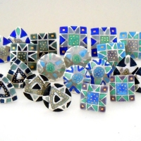 Selection of etched and enamelled earrings