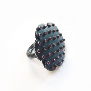 Early 2000's: Marianne Anderson. Ring - oxidised silver and red glass.