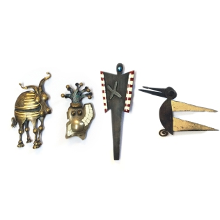 1988: Abbott & Ellwood. Brooches (left-right) Mike Abbott - Mad Cow Disease, brass. Jester, Brass. Kim Ellwood - Steel, gold leaf & enamel